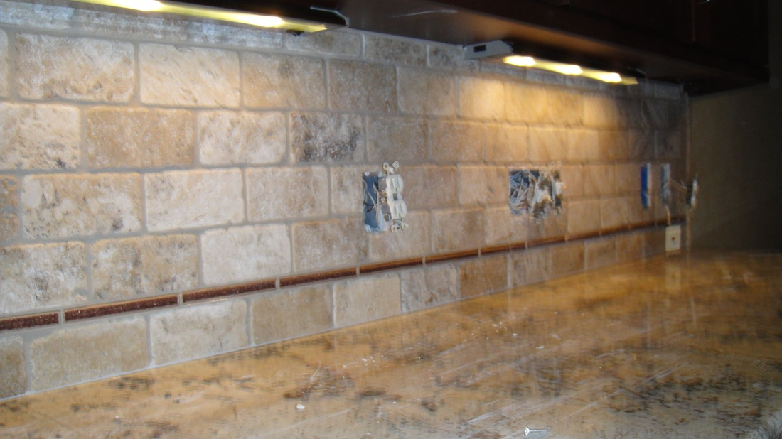 Russo custom tile and stone middleburg heights ohio 44130 mosaic and tumbled limestone tile for Tumbled glass tile